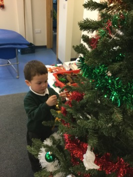 The children did a great job decoration our class Christmas tree, it looks very festive.